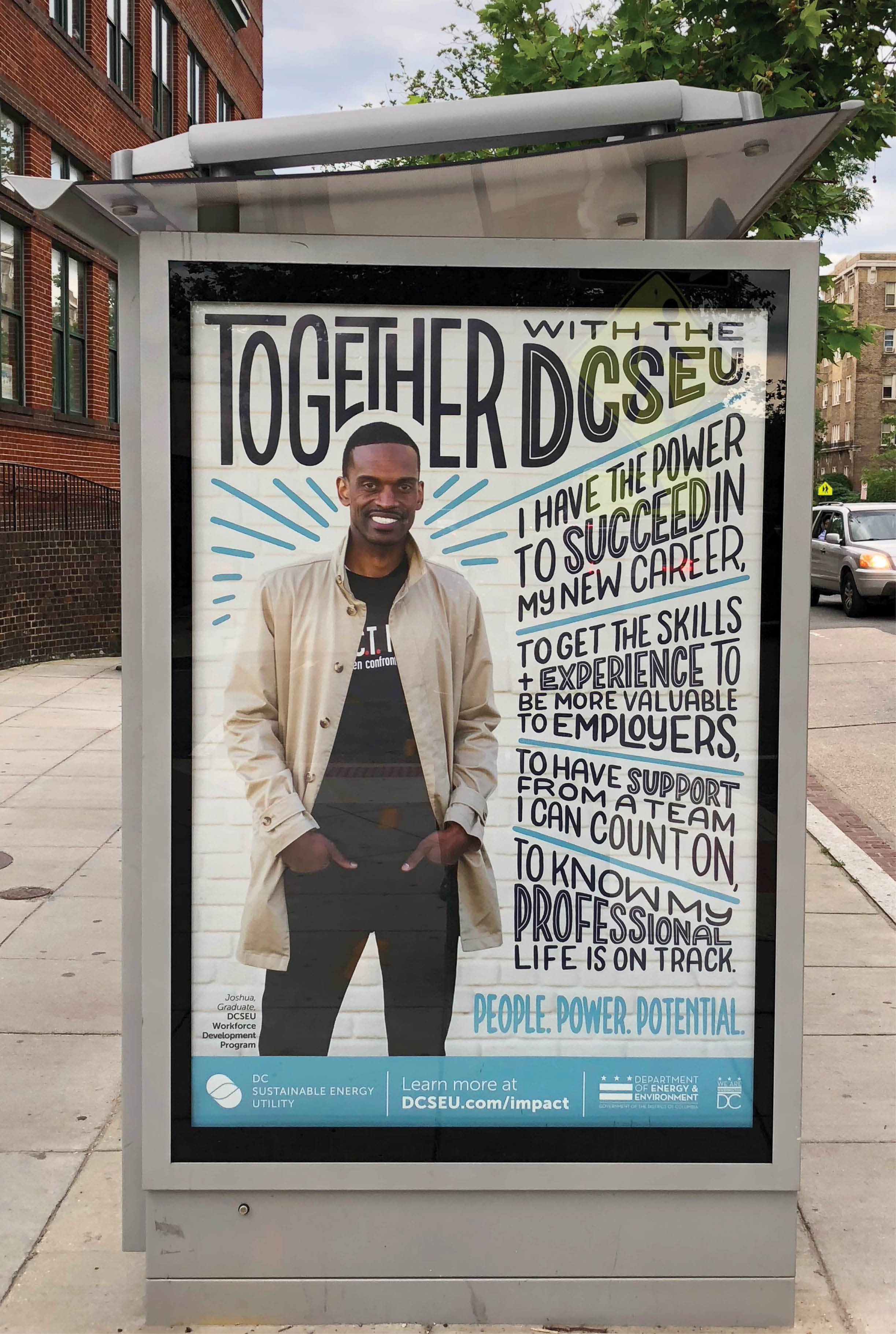 Image of bus shelter poster, featuring a man smiling with his hands in his pockets. He stands against a while wall and is surrounded by blue hand lettering featuring his testimonial about using the DCSEU workforce development programs.