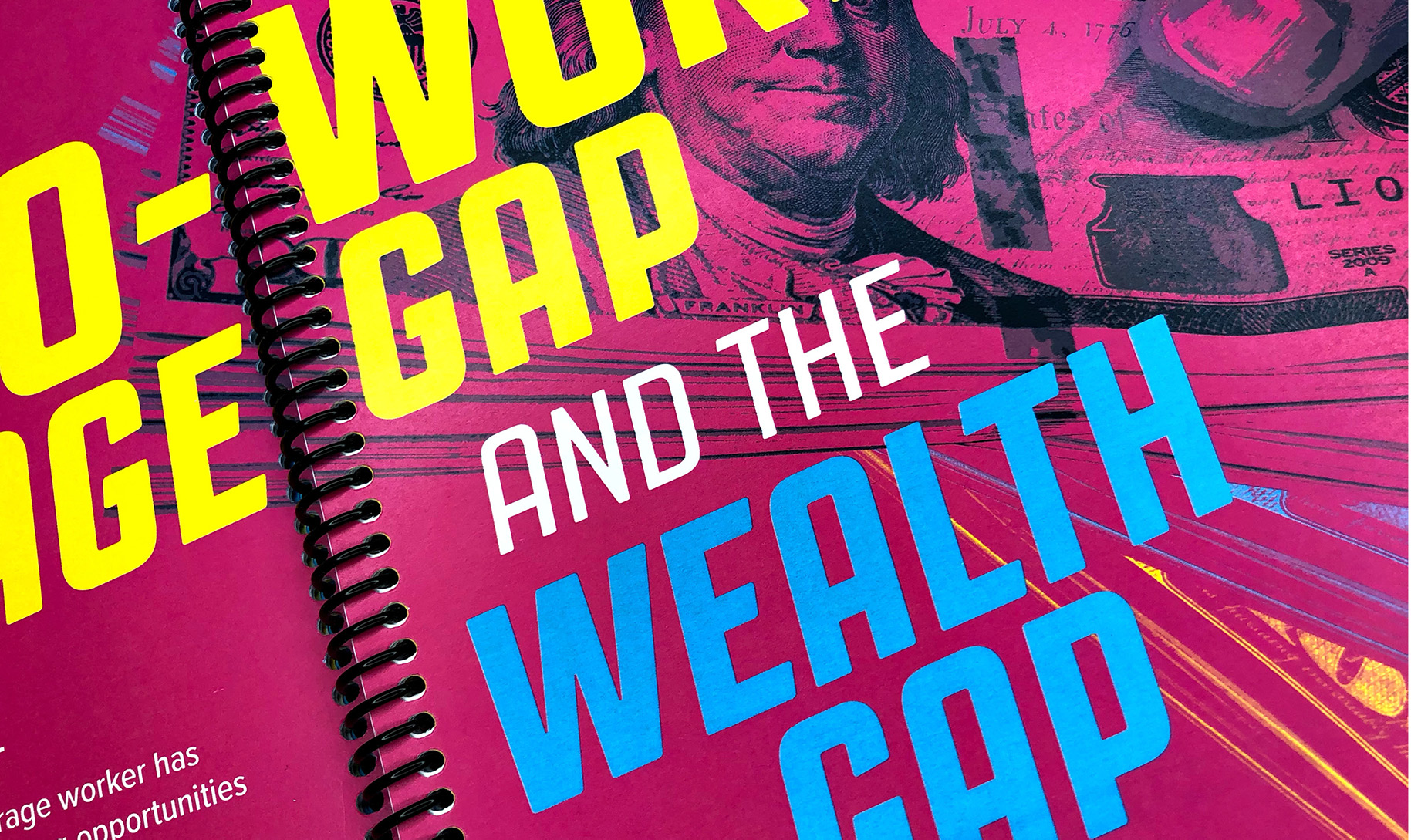 Close-up of book spread with photocollage expressing the wage gap